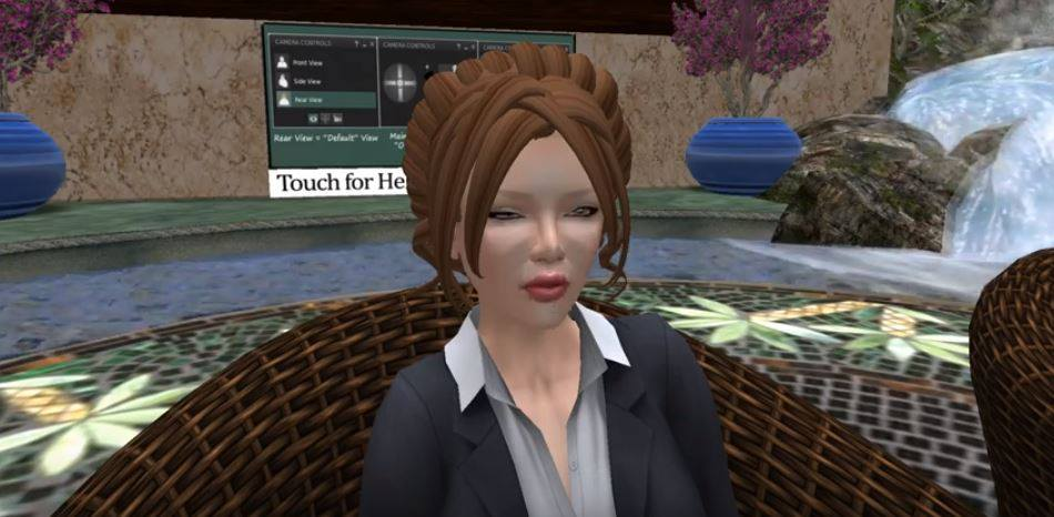 A picture of my avatar presenting at a mental health symposium organized by Virtual Ability, Inc. and held in Second Life.